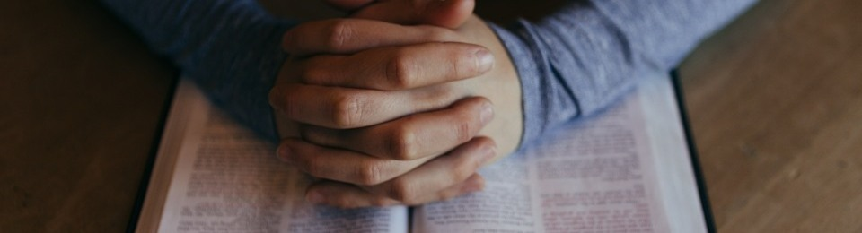 hands clasped together in prayer for the nation